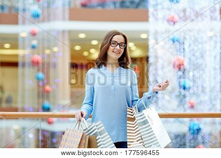 Contemporary woman with paperbags spending time in the mall