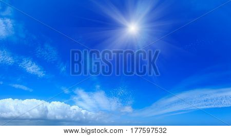 Sunshine And Clouds In Blue Sky.