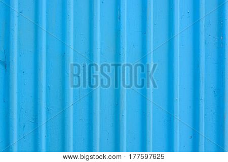 Texture of fluted ribbed iron metal plate background