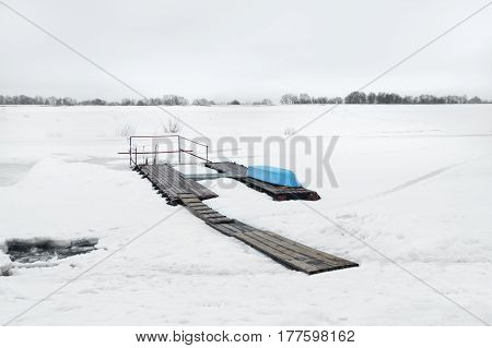 Nature in a winter season with boat on the river