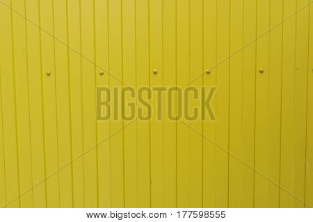 Closeup of yellow corrugated metal surface background