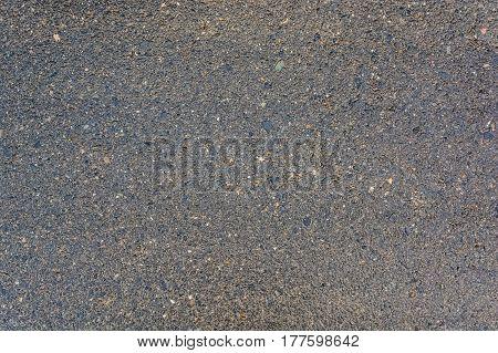 Closeup of wet asphalt road texture background