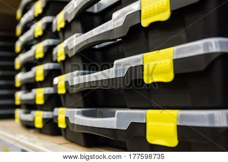 Close up of empty plastic toolboxes in supermarket