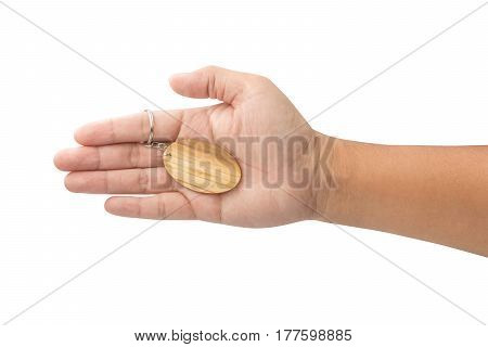 hand holding wooden Keychain isolated on white background with clipping path
