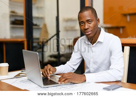 Engineering expert working online in office