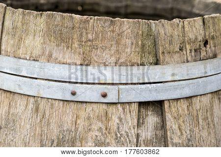 Detail of old vintage wooden barrel with metal hoops