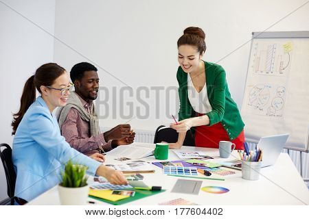 Business group analyzing new data on paper