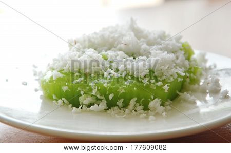 green coconut sweet pudding on white dish