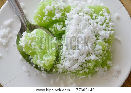 green coconut sweet pudding on stainless spoon