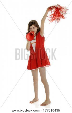 A pretty elementary girl cheering with her red and white pompom, megaphone and uniform.  On a white background.