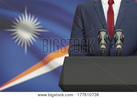 Businessman Or Politician Making Speech From Behind A Pulpit With National Flag On Background - Mars
