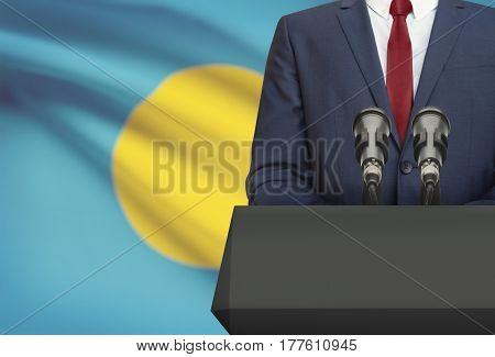 Businessman Or Politician Making Speech From Behind A Pulpit With National Flag On Background - Pala