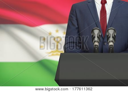 Businessman Or Politician Making Speech From Behind A Pulpit With National Flag On Background - Taji