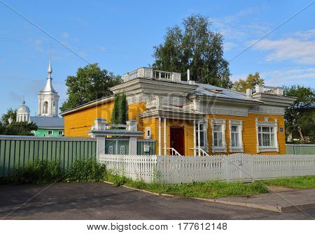 Old wooden house with carved palisade in Vologda, Russia