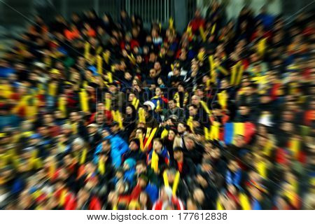 Motion Blurred Crowd In A Stadium. Zoom In Effect