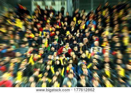 Blurred, Defocused Fans On A Stadium Tribune