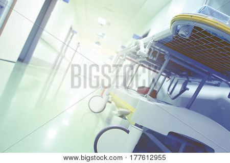 Bright clinic hallway with gurney. Conceptual photo