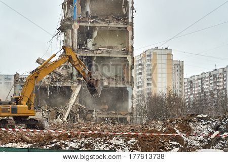 Builders demolishing a house in the city