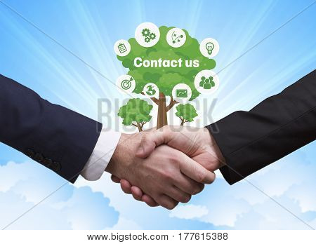Technology, The Internet, Business And Network Concept. Businessmen Shake Hands: Contact Us