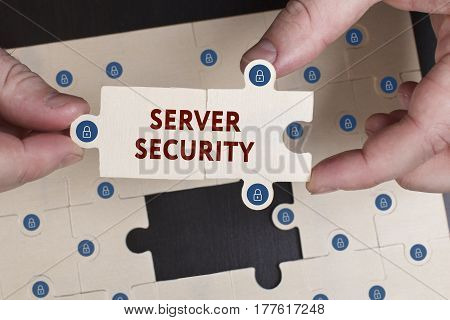 Business, Technology, Internet And Network Concept. Young Businessman Shows The Word: Server Securit