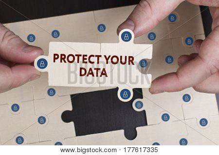 Business, Technology, Internet And Network Concept. Young Businessman Shows The Word: Protect Your D