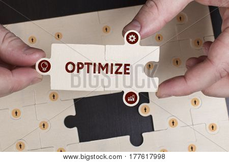 Business, Technology, Internet And Network Concept. Young Businessman Shows The Word: Optimize