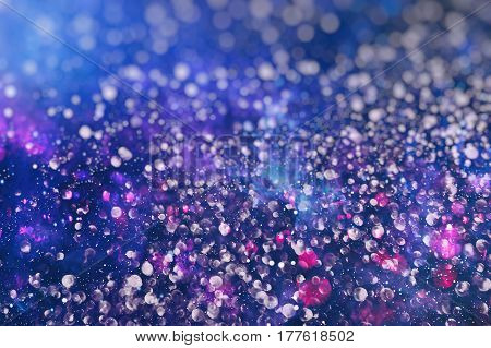 Abstract Festive background. Glitter vintage lights background with lights defocused. Christmas and New Year feast bokeh background with copyspace.