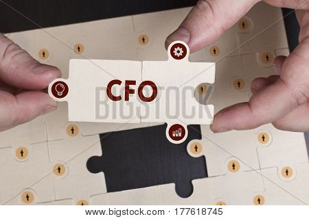 Business, Technology, Internet And Network Concept. Young Businessman Shows The Word: Cfo