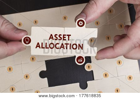 Business, Technology, Internet And Network Concept. Young Businessman Shows The Word: Asset Allocati