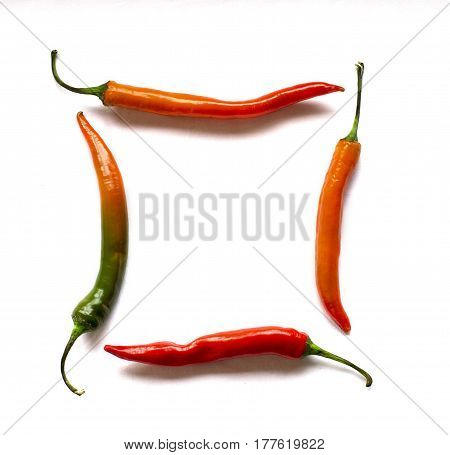 four of Cayenne pepper in the form of a square on a white background