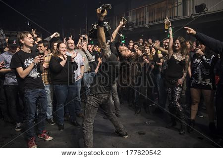 Amsterdam The Netherlands - March 19 2017: audience cheering while guitarist of Norwegian hard rock band Audrey Horne plays in the crowd support act of Canadian hard rock heavy metal band Danko Jones at Melkweg