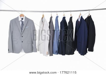 Row of men's suits hanging
