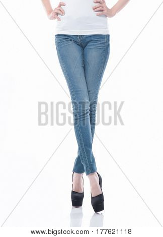 women crossing her leg in jeans front views isolated on white background.