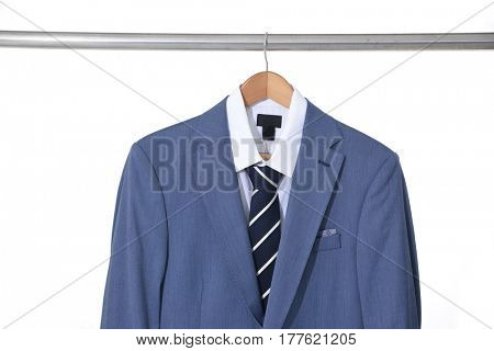Set of blue men's suits ,shirt on hanging