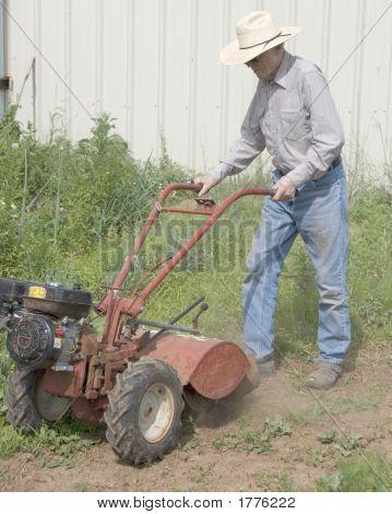 Old Man Plowing Field