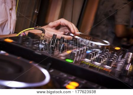 detail of a Console dj during a festival of electronic music