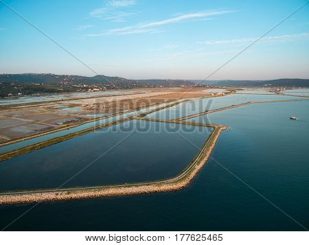 Soline in Slovenia at sunset place of extraction of sea salt aerial panoramic photo. Secovljske Soline.