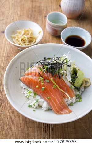 Traditional Japanese Hokkaidon - Thinly sliced salmon Donburi as close-up in a bowl