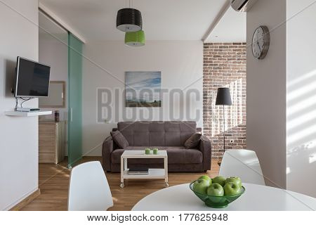 Interior of a new modern apartment in scandinavian style with green apples
