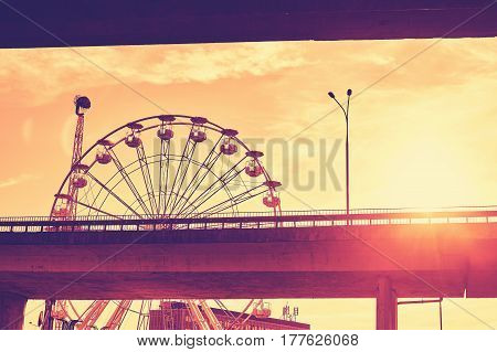 Color Toned Picture Of A Ferris Wheel Against The Sunset