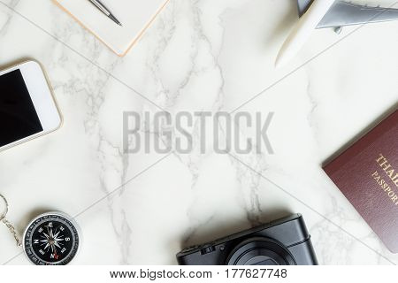 Luxury traveler objects on marble surface with copy space