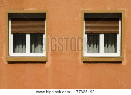 Architectural photography of two shaded windows orange