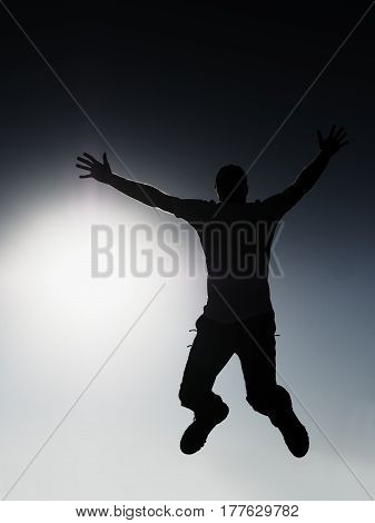 Crazy Man Is Flying Over Sun On Blue Sky Background.