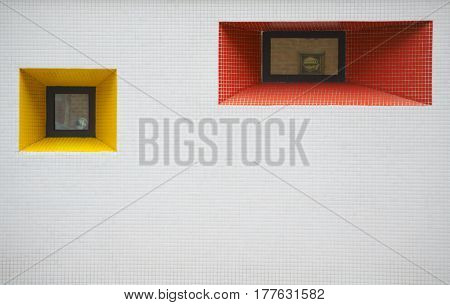 Architectural photography with two windows yellow red