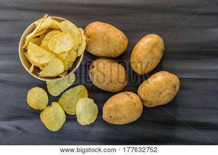 potatoes and potato products, fried potato slices, potato slices fried serrated, fried potato flakes in a furnace,fried potato chips