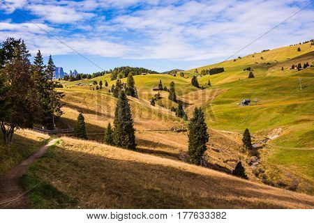 The natural landscape of the Alps di Siusi. The famous winter ski resort in autumn. Fabulous mountain valley. The concept of an active and eco-tourism