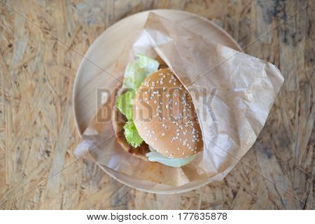 Hamburgers with fresh vegetables on craft wrapping paper