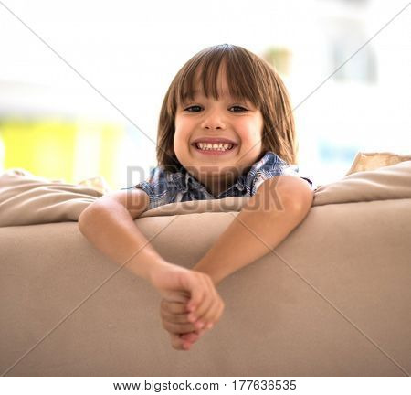 Child on sofa at home