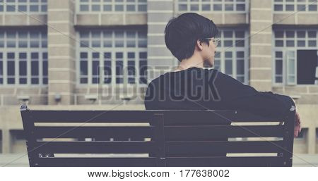 Asian Guy Sitting Bench Watching Enjoy