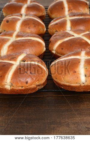 closeup of rows of hot cross buns cooling